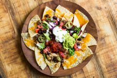 Homemade Nachos with tortilla chips cheese and guacamole Stock Images