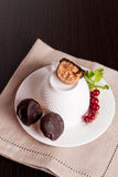 Homemade natural chocolates with marzipan on black background. Vertical Stock Photo