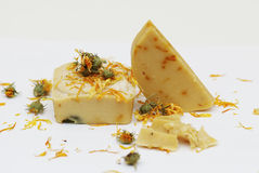 Homemade natural marigold soap. Close up on white background stock photo