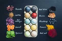 Homemade naturally dyed Easter eggs stock images