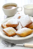 Homemade new orleans beignet donuts with plenty of powdered sugar Stock Photos