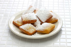 Homemade new orleans beignet donuts with plenty of powdered sugar Royalty Free Stock Photo