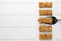 Homemade no bake granola bars on white wooden background. Royalty Free Stock Photos