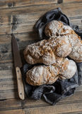 Homemade no kneading whole wheat rustic bread on wooden table Royalty Free Stock Photography