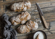Homemade no kneading whole wheat rustic bread on wooden table Royalty Free Stock Images