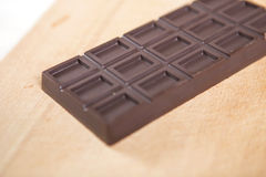 Homemade no sugar proper nutrition chocolate bar on a wooden bac Royalty Free Stock Photography