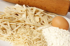 Homemade noodels. Homemade pasta with a rolling pin, egg and flour Stock Photography