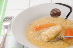 Homemade noodle soup served at the table stock photography