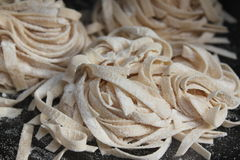 Homemade noodles. Detail on the black background stock photo