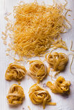 Homemade noodles and pasta. On wooden table Stock Images