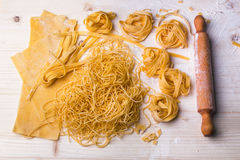 Homemade noodles and pasta. On wooden table Royalty Free Stock Photos