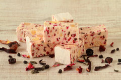 Homemade nougat with red dried fruit Royalty Free Stock Photo