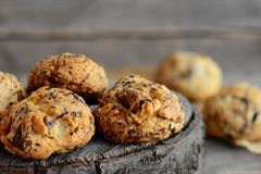 Homemade nut biscuits on a wooden background. Sweet pastry with walnuts. Closeup Stock Photo