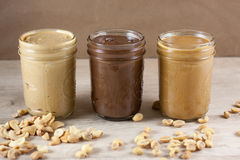 Homemade Nut Butters. In canning jars Stock Photos