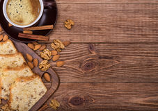 Homemade nut cake with cup of coffe . Homemade nut cake with cup of coffe on wooden background Royalty Free Stock Image