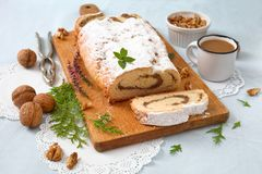 Homemade nut roll. With powdered sugar stock photo