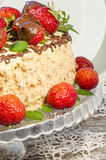 Homemade nutty cake with strawberries. Macro, vertical Stock Image