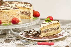 Homemade nutty cake with strawberries and slice of cake Stock Photo