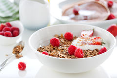 Homemade oat meal granola or muesli with fresh summer fruits – raspberry and strawberry with yogurt Royalty Free Stock Photo