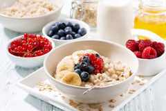 Homemade oatmeal with berries for breakfast on table Royalty Free Stock Images