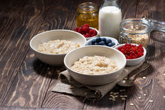 Homemade oatmeal and berries on wooden background Royalty Free Stock Photography