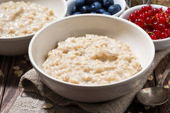 homemade oatmeal and berries on wooden table, closeup Stock Photo