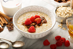 Homemade oatmeal for breakfast. With raspberry, cinnamon and honey Royalty Free Stock Images