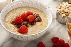 Homemade oatmeal for breakfast. With raspberry, cinnamon and honey Royalty Free Stock Photo