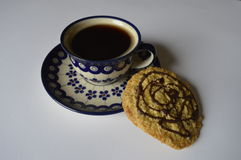 Homemade oatmeal cookie with coffee. Homemade cookie, oatmeal cookie with chocolate, with cup of coffee, black coffee Stock Images