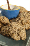 Homemade oatmeal cookies. In plate and blue bowl stock images