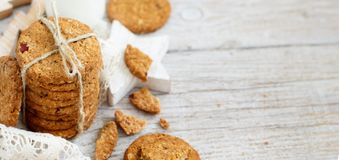Homemade oatmeal cookies. With christmas decorations close up stock photography