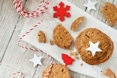 Homemade oatmeal cookies. With christmas decorations top view royalty free stock photo
