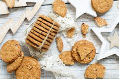 Homemade oatmeal cookies. With christmas decorations top view royalty free stock image