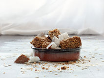Homemade oatmeal cookies with coconut in a bowl. Delicious fresh baked oatmeal cookies with coconut, served in a ceramic bowl Royalty Free Stock Photos
