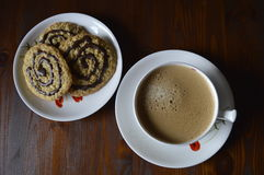 Homemade oatmeal cookies with coffee. Homemade cookies, oatmeal cookies with chocolate, healthy biscuits, with cup of coffee, milk coffee royalty free stock image