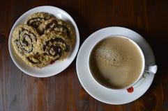 Homemade oatmeal cookies with coffee. Homemade cookies, oatmeal cookies with chocolate, healthy biscuits, with cup of coffee, milk coffee stock photo