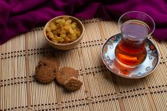 Homemade oatmeal cookies with a cup of tea on old wooden background, A cup of tea with raisin, a cup of tea with chocolate royalty free stock photos