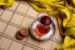 Oatmeal cookies with a cup of turkish tea on wooden background royalty free stock image
