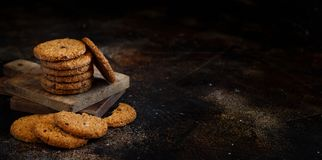 Homemade oatmeal cookies. On a dark background close up royalty free stock images