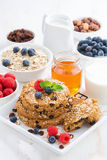 Homemade oatmeal cookies for a healthy breakfast, vertical Stock Image