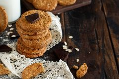 Homemade oatmeal cookies. With chocolate on a dark background royalty free stock image
