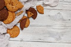 Homemade oatmeal cookies. On a wooden background close up royalty free stock image