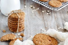 Homemade oatmeal cookies. With milk on a wooden table close up royalty free stock photo
