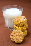 Homemade oatmeal cookies with pumpkin and a glass of milk Stock Image