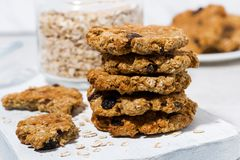 Homemade oatmeal cookies with raisins on wooden board. Closeup stock photos