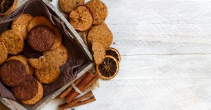 Homemade oatmeal cookies. With spices and pine cones royalty free stock photography