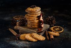 Homemade oatmeal cookies. With spices and pine cones royalty free stock photos