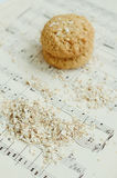 Homemade oatmeal cookies on vintage music sheet Stock Photography