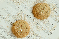 Homemade oatmeal cookies on vintage music sheet Stock Photos