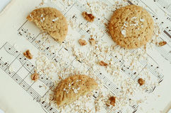 Homemade oatmeal cookies with walnut on vintage music sheet Stock Images